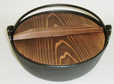 Japanese cast iron pot with wooden cover
