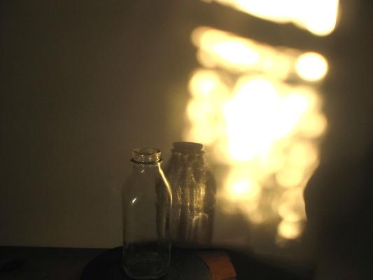 Milk bottle reflexion, photograph by Ven. Anzan Hoshin roshi