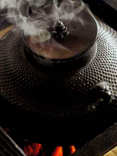 Japanese iron tea pot over a fire