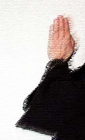 Hands in gassho from the side, treated photograph